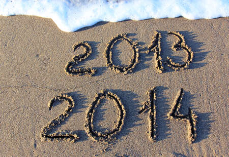 replace: Happy New Year 2014 replace 2013 concept on the sea beach Stock Photo