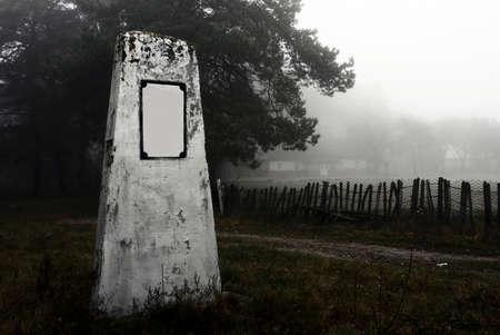 tomb empty: A single tombstone near a foggy road