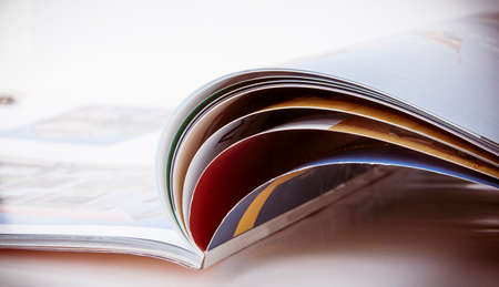 periodical: The opened magazine. Focus on an upper edge of pages.