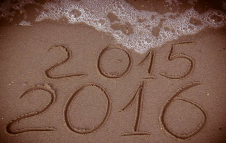 replace: Happy New Year 2016 replace 2015 concept on the sea beach Stock Photo