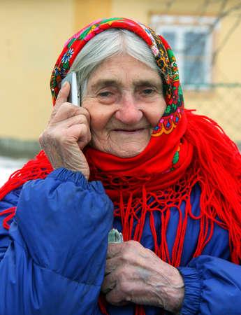 01: VLADIMIRETS, UKRAINE - FEBRUARY 01 - A portrait of senior woman talking on cell phone in Vladimirets on February 01, 2013.