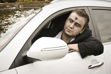 october 31: LUTSK - OCTOBER 31: A driver with a shot through the head at Halloween on October 31, 2012 in Lutsk, Ukraine.