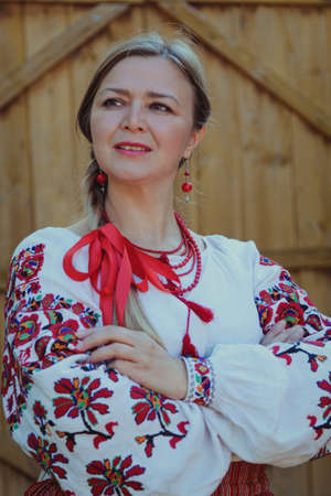 affable: Portrait of woman middle age in the Ukrainian national clothes Stock Photo