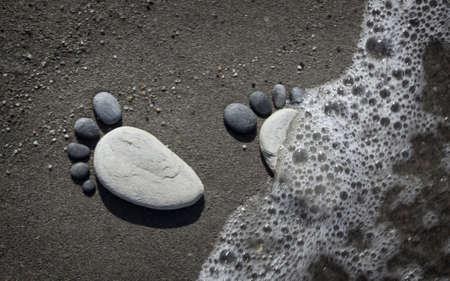 Stone arranged like a footprint on the beach