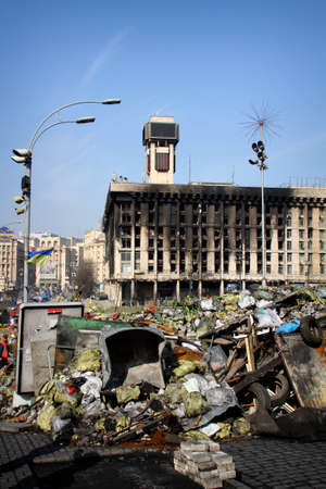 barricades: KIEV, UKRAINE - MARCH 3, 2014: Barricades and Trade Unions building burnt down by riot police at center of Kiev after Ukrainian revolution, Euromaidan.