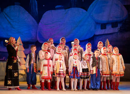 chorale: LUTSK - JANUARY 20: Children choir performs in the theater at a charity concert Christmas carol with Tatiana Tsihotska to raise funds for Ukrainian Army on January 20, 2016 in Lutsk, Ukraine.