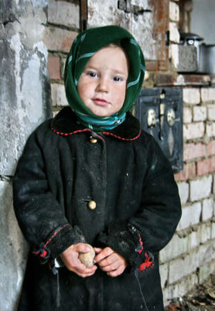 beggar: RIVNE, UKRAINE - NOVEMBER 04 - Poor beggar child standing in a home after fire in Rivne on November 11, 2008. Editorial