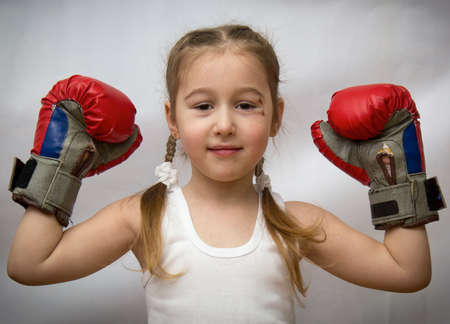 bruise: The little girl with pigtails and a bruise under the eye in boxing gloves