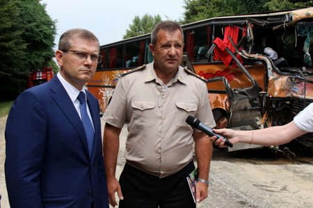 heartbreaking: KOVEL, UKRAINE - JULY 11: Vice Prime-Minister of Ukraine Oleksandr Vilkul (left) at place of bus crash where nine Ukrainian, Belarusian and Bulgarian Tourists were died and as many as 30 others were injured July 11, 2013 just outside Kovel, Ukraine.