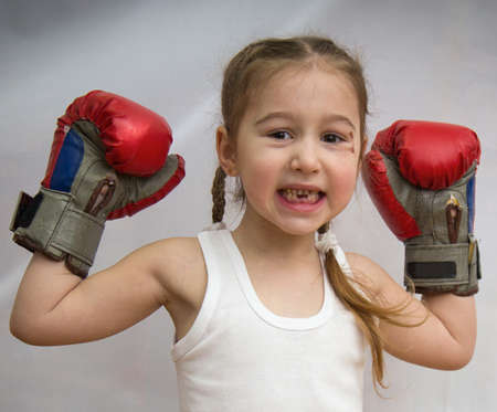 toothless: The little toothless girl with pigtails and a bruise under the eye in boxing gloves