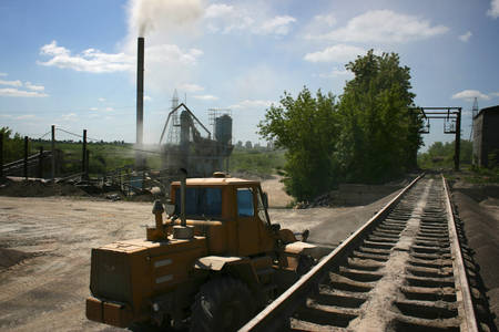 wheel loader: Wheel loader excavator next railway on a sunny day