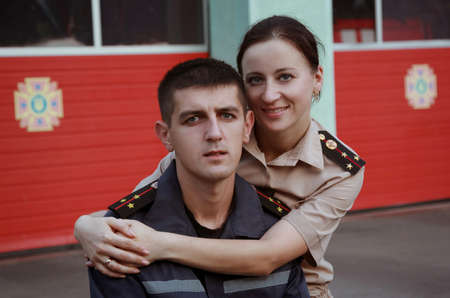 ministry: Young man and woman in ukrainian costume officers of the Ukrainian Ministry of Emergency Situations