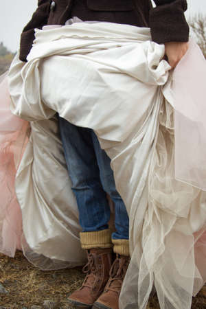 simultaneously: The woman wore jeans and simultaneously wedding dress