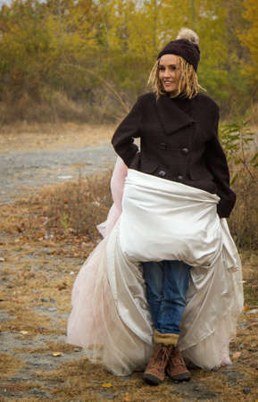 simultaneously: Woman wore jeans and simultaneously wedding dress