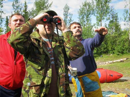 adventuring: KOLSKY, UKRAINE - AUGUST 07: Three men with binoculars while on a hike on August 07, 2008 in Kolsky, Ukraine.