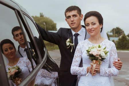windowpane: Bride with groom reflexion in a windowpane of car Stock Photo