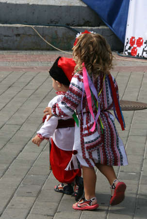 cossack: Lutsk, Ukraine - Аugust 24, 2012: Children in national costumes during Ukraine Independence Day Editorial