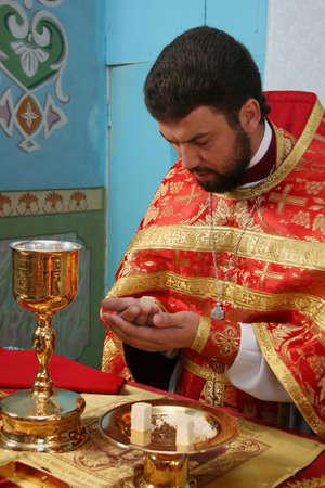 liturgy: LUTSK, UKRAINE - NOVEMBER 02 - Priest consecrates bread during orthodox liturgy ceremony in Lutsk on November 02, 2008.