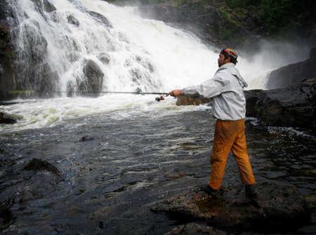 12 13: BUG, UKRAINE - AUGUST 13 - Man fishing near waterfall in Bug on August 12, 2008 Editorial