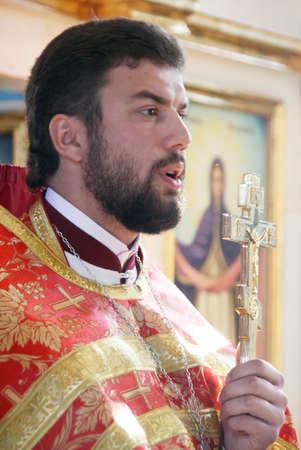 cassock: LUTSK, UKRAINE - NOVEMBER 02 - Orthodox priest during holiday prayers in Lutsk on November 02, 2008.
