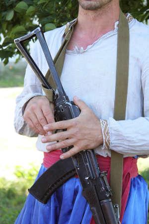 ak47: Man in Ukrainian linen shirt and trousers with rifle AK-47 Stock Photo