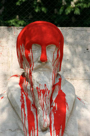 reformation: Reformation wall in Geneva, Switzerland. Statue of John Calvin pour paint.