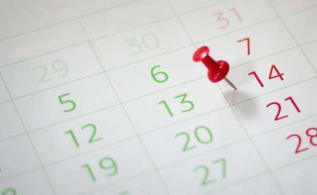 personal decisions: Calendar with red push pin. Shallow depth of field. Stock Photo