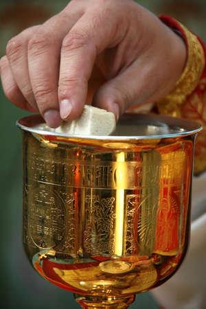 religion ritual: LUTSK, UKRAINE - NOVEMBER 02 - Hands of priest consecrates bread during orthodox liturgy ceremony in Lutsk on November 02, 2008.