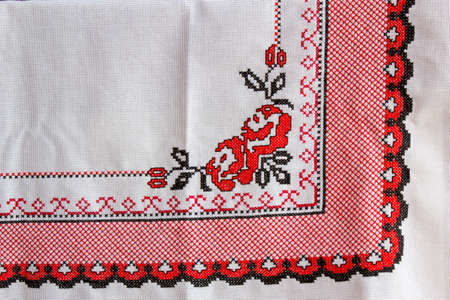 embroidered: Tablecloth with embroidered flower and decorative ornament