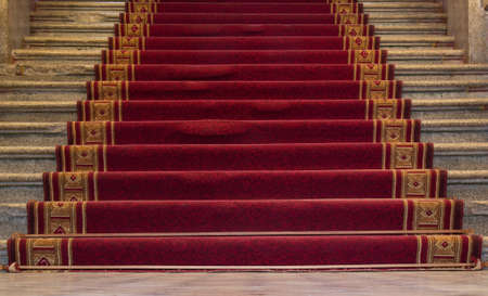 occasions: Red carpet on a stairway used to mark the route taken by heads of state, vips and celebrities on ceremonial and formal occasions or events