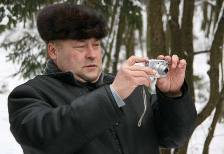 sheepskin: CUMAN, UKRAINE - 19 January 2010: Ukrainian man in a fur cap and sheepskin coat photographed in the winter park Editorial