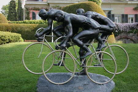 LAUSANNE, SWITZERLAND - MAY 03, 2009: Cyclists, sculpture by Gabor Mihaly, at Olympic museum in Lausanne, Switzerland