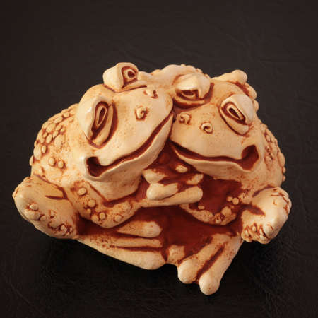 animal figurines: Figures of two ceramic embracing frogs