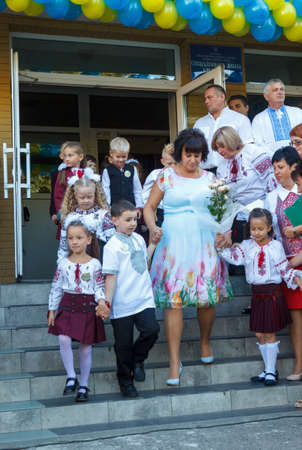beginning school year: LUTSK, UKRAINE - 01 September 2016: A teacher leads children hand at the celebratory assembly, devoted to the beginning of the school year Editorial