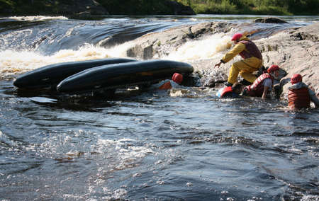 spurt: KOLSKYY, RUSSIA - 17 August 2008: The catamaran is turning over in the rapid river