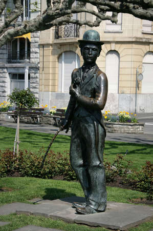 screenwriter: VEVEY, SWITZERLAND - 03 MAY 2009: Bronze statue of comedian actor Charlie Chaplin on the promenade in Vevey (Vaud), Switzerland.