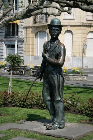 vevey: VEVEY, SWITZERLAND - 03 MAY 2009: Bronze statue of comedian actor Charlie Chaplin on the promenade in Vevey (Vaud), Switzerland.