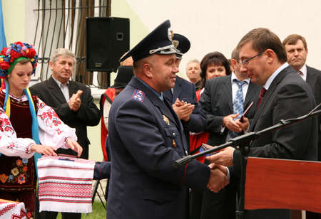 affairs: ZHURAVYCHI, UKRAINE - 12 September 2008: Minister of Internal Affairs Yuriy Lutsenko (right) awarded officer during the Ceremonial opening of temporary residence of foreigners and stateless persons