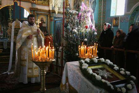 cassock: VOYUTYN, UKRAINE - 08 JANUARY 2009: Orthodox priest during Christmas service Editorial