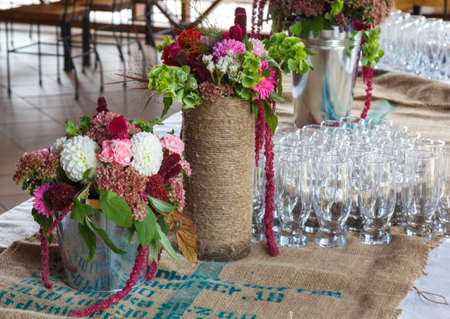 Formal Table Setting For A Wedding With Floral Centerpiece And