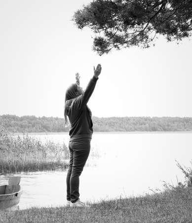 woman meditating: Woman meditating harmony with nature