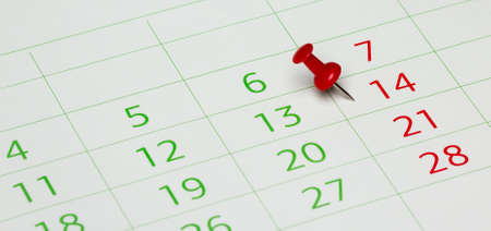 booked: Calendar with red push pin.  Stock Photo