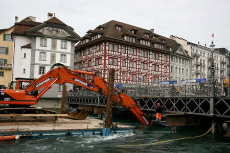 LUZERN, SWITZERLAND - 05 May 2009: Working on the dredger clears the bottom of the canal