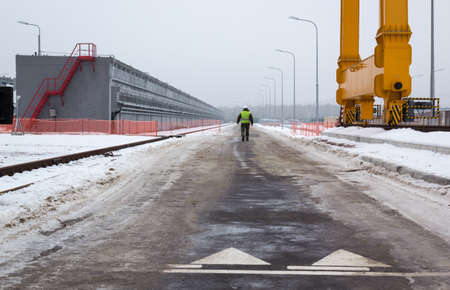 fuel storage: CHERNOBYL, UKRAINE - December, 2016: Worker of the Chernobyl nuclear power plant is near spent nuclear fuel storage