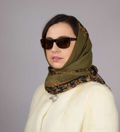 Portrait of glamor woman in sunglasses and headscarf