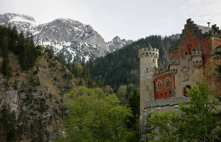 view of world-famous Neuschwanstein Castle, the 19th century Romanesque Revival palace built for King Ludwig II, with scenic mountain landscape near Fussen, southwest Bavaria, Germany Editorial