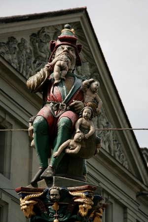 BERN, SWITZERLAND - 03 May 2009: Kindlifresserbrunnen sculpture (Child Eater Fountain) at the Kornhausplatz