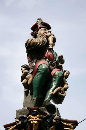 unrivaled: BERN, SWITZERLAND - 03 May 2009: Kindlifresserbrunnen sculpture (Child Eater Fountain) at the Kornhausplatz