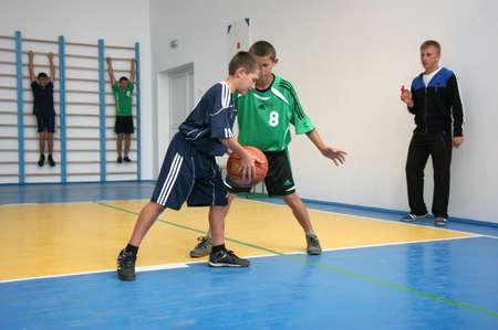 MULCHYCI, UKRAINE - 04 September 2012: Boys playing basketball in the school