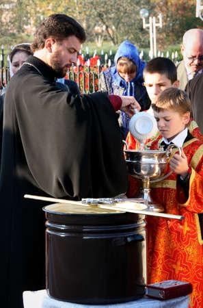 sotana: VOYUTYN, UKRAINE - 14 OCTOBER 2008: Slavonic Religious celebration Pokrov